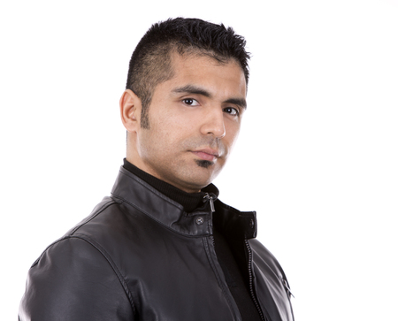 spanish ethnicity: young casual man wearing black jacket on white background