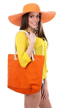 yellow shirt: young woman wearing yellow shirt and orange hat on white background