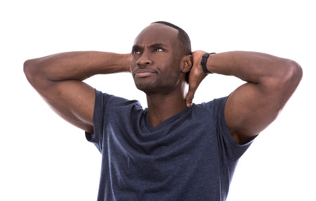 funny people: young casual black man wearing blue tshirt on white background