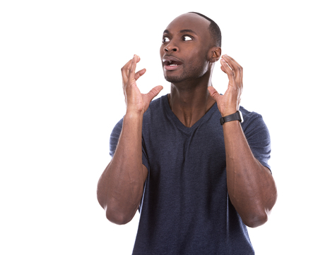 freaked out: young scared casual black man on white background