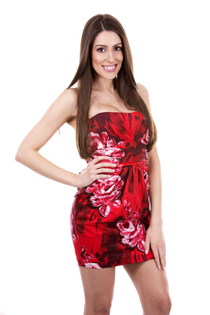 girls youth: young woman wearing red dress on white background Stock Photo