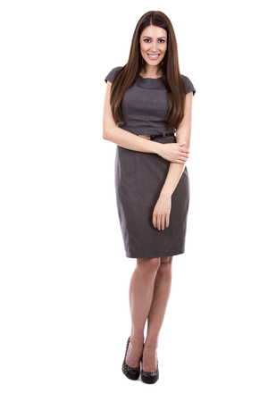 woman dress: young caucasian woman wearing business dress on white background