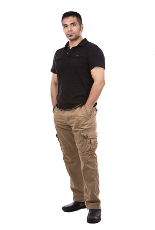 spanish looking: young casual man wearing black tshirt on white background Stock Photo