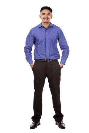 standing businessman: young business man posing on white isolated background