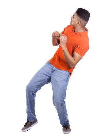 freaked: young casual man wearing orange tshirt on white isolated background Stock Photo