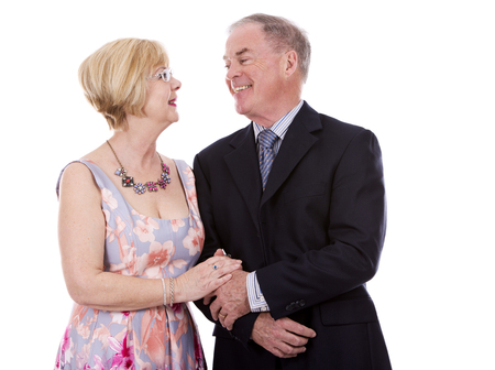 expressing positivity: retired couple dressed up on white isolated background