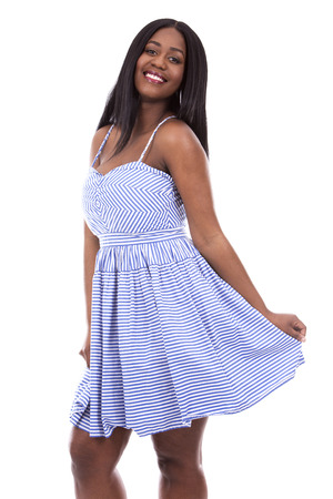 woman in black: young black woman wearing blue dress on white background