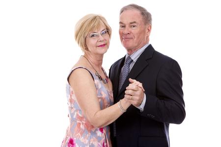 gente bailando: retired couple dressed up on white isolated background