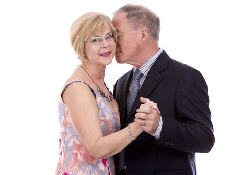 dress suit: retired couple dressed up on white isolated background