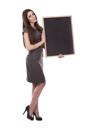 woman work: young caucasian woman holding a chalboard on white background Stock Photo