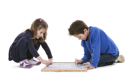 small girl: girl and boy playing with chalk board on white isolated background