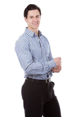white man: young caucasian man wearing blue shirt and black pants on white background