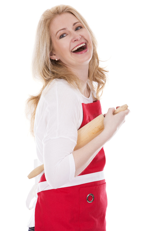 beautiful middle aged woman: blond woman wearing red apron on white isolated background
