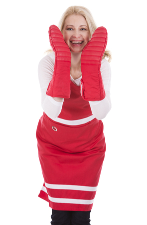 blond woman wearing red apron on white isolated background photo