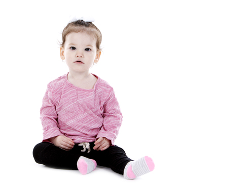 black pants: pretty little girl playing wearing pink top and black pants