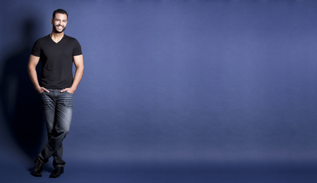 east asian handsome man wearing black tshirt and jeans Stockfoto