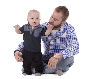 baby isolated: casual father and son sitting on white isolated background