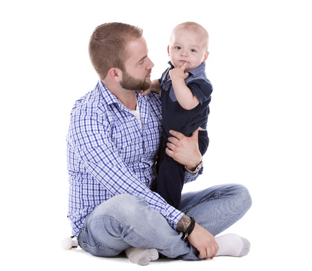 nephew: casual father and son sitting on white isolated background