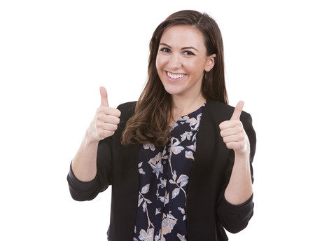 winning mood: young caucasian woman wearing business attire on white background Stock Photo