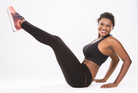 ethnicity: young black woman wearing fitness outfit on white isolated background