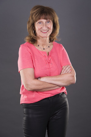 mature women: older caucasian woman wearing casual outfit on grey background Stock Photo
