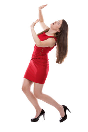 red dress: young caucasian woman wearing business attire on white background Stock Photo