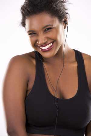 woman black background: young black woman wearing fitness outfit on white isolated background