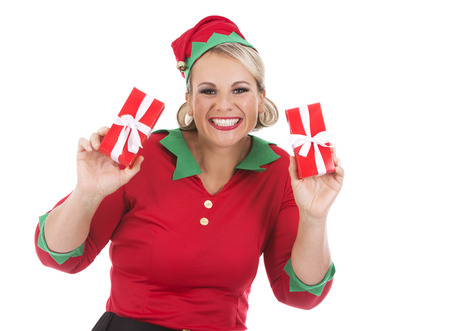 blonde woman wearing elf christmas costume on white background