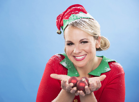 blond girl: blonde woman wearing elf christmas costume on blue background