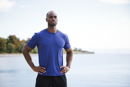 male athlete: young black man wearing athletic wear on the beach Stock Photo
