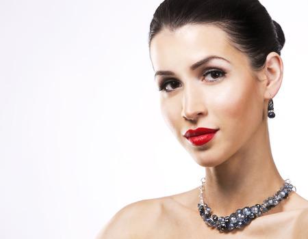 romantic woman with dramatic makeup and nailpolish. Big blue silver fashion necklace. Whitebackground. Stock Photo