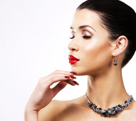 nailpolish: romantic woman with dramatic makeup and nailpolish. Big blue silver fashion necklace. Whitebackground. Stock Photo