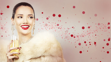 upscale: Upscale woman wearing gold jewellery and red lipstick. Red hearts. Light background. Stock Photo