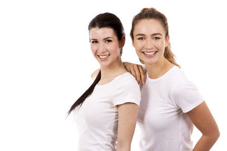 young casual caucasian women wearing white tshirt and blue jeans on white isolated background