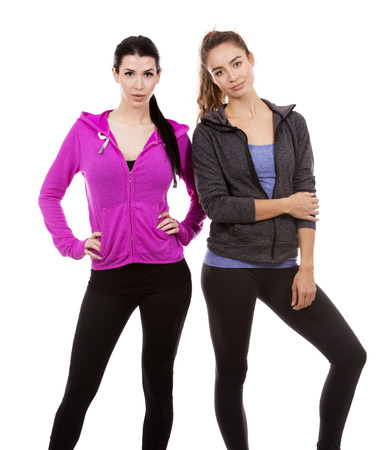 young casual caucasian women wearing sport outfits on white isolated background. photo