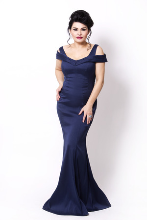 elegant woman wearing evening gown in dark blue or navy color on white background 版權商用圖片