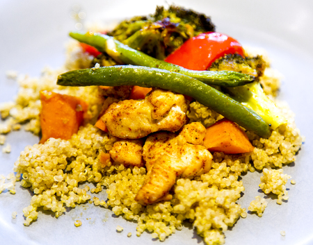 dairy free, gluten free, anti-inflammatory pan with chicken and vegetables, healthy light lunch with goat marble cheese and quinoa