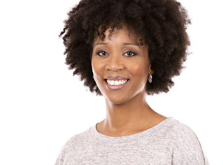 beautiful casual black woman wearing light top on white isolated background Standard-Bild