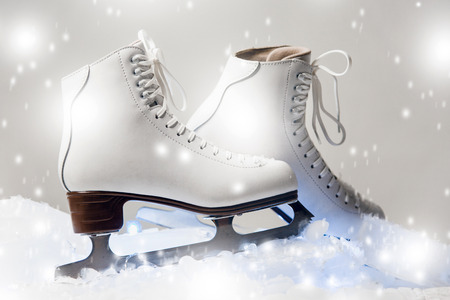 white figure skates on blocks of ice in the studio settings