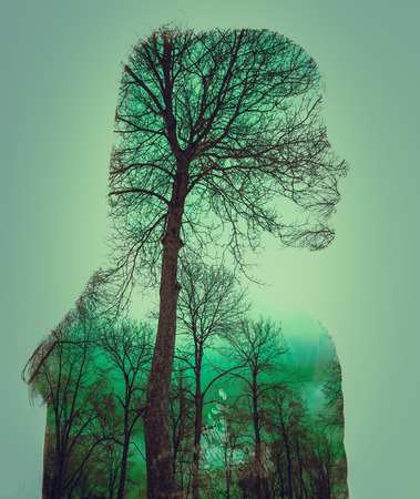 green double exposure of nature and females profile