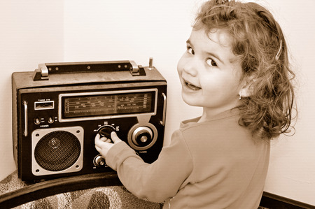 Sweet young girl and retro dusty radio Stok Fotoğraf