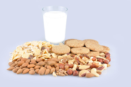 Healthy food and glass of milk  isolated on light blue background photo