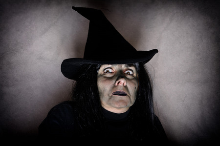witch face: Portrait of afraid halloween witch with green face Stock Photo