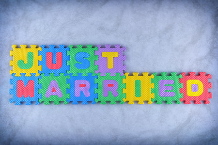 Just married sign made out of alphabet puzzle pieces photo