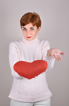 Woman holding a plush red heart on Valentines day photo