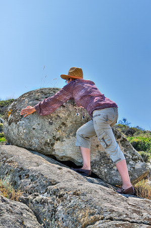 persistent: Strong and persistent woman moving the rock on the hill. Added HDR effect.