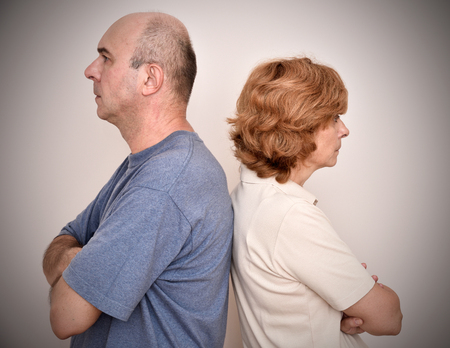 backs: Angry woman and man turning their backs to each other