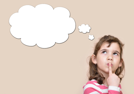 Thoughtful young girl with an empty thought bubble Foto de archivo
