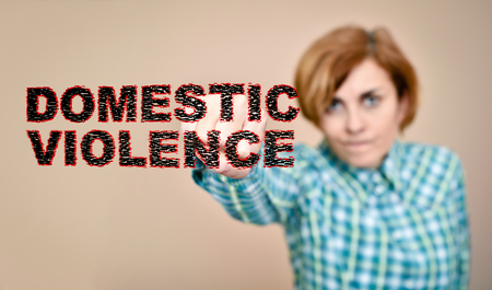 Angry woman hitting and breaking words domestic violence with her fist. Selective focus.