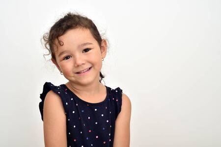 Portrait of a smiling cute young girl. Copy space on the right side.